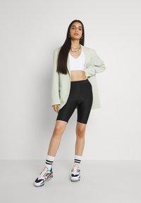 Monki - EDDA SHINY - Shorts - black dark - 1