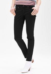 s.Oliver BLACK LABEL - Trousers - secret black - 0