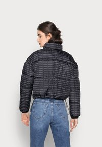 Missguided Tall - ALL OVER SMALL BRANDED PUFFER - Winter jacket - black - 2