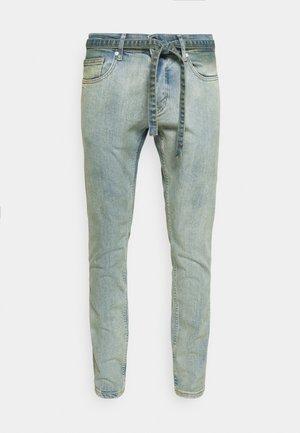 MOURA - Zúžené džíny - straw blue