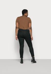 Vero Moda Curve - VMJUDY - Slim fit jeans - black - 2