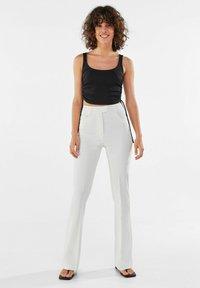 Bershka - Trousers - white - 1