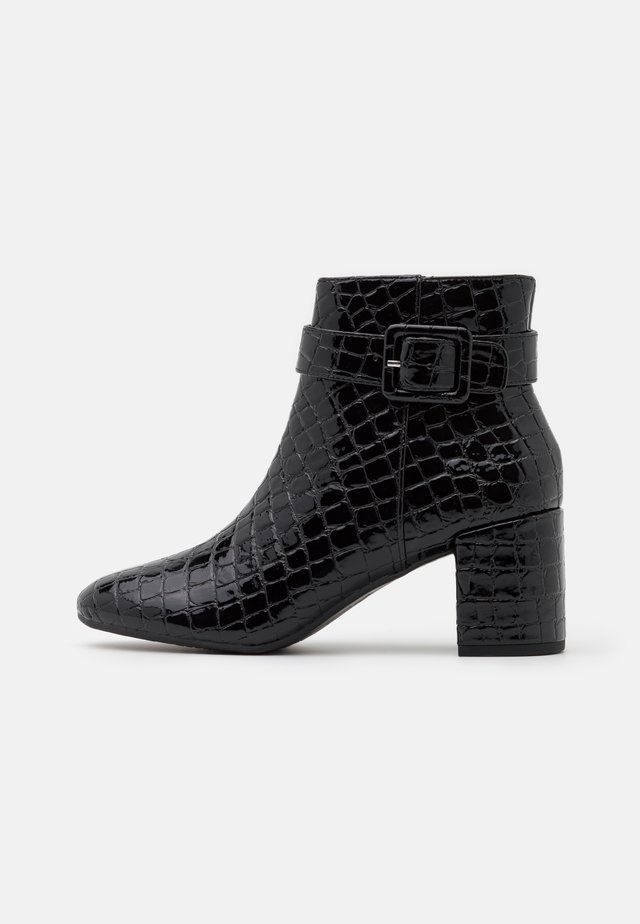 ANDI COVERED BUCKLE - Ankle boots - black