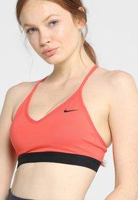 Nike Performance - INDY  - Brassières de sport à maintien léger - ember glow/black - 4