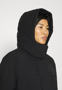 Calvin Klein Jeans - ECO PUFFER JACKET - Vinterjakke - black - 3