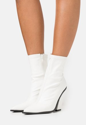 VEGAN - High heeled ankle boots - white