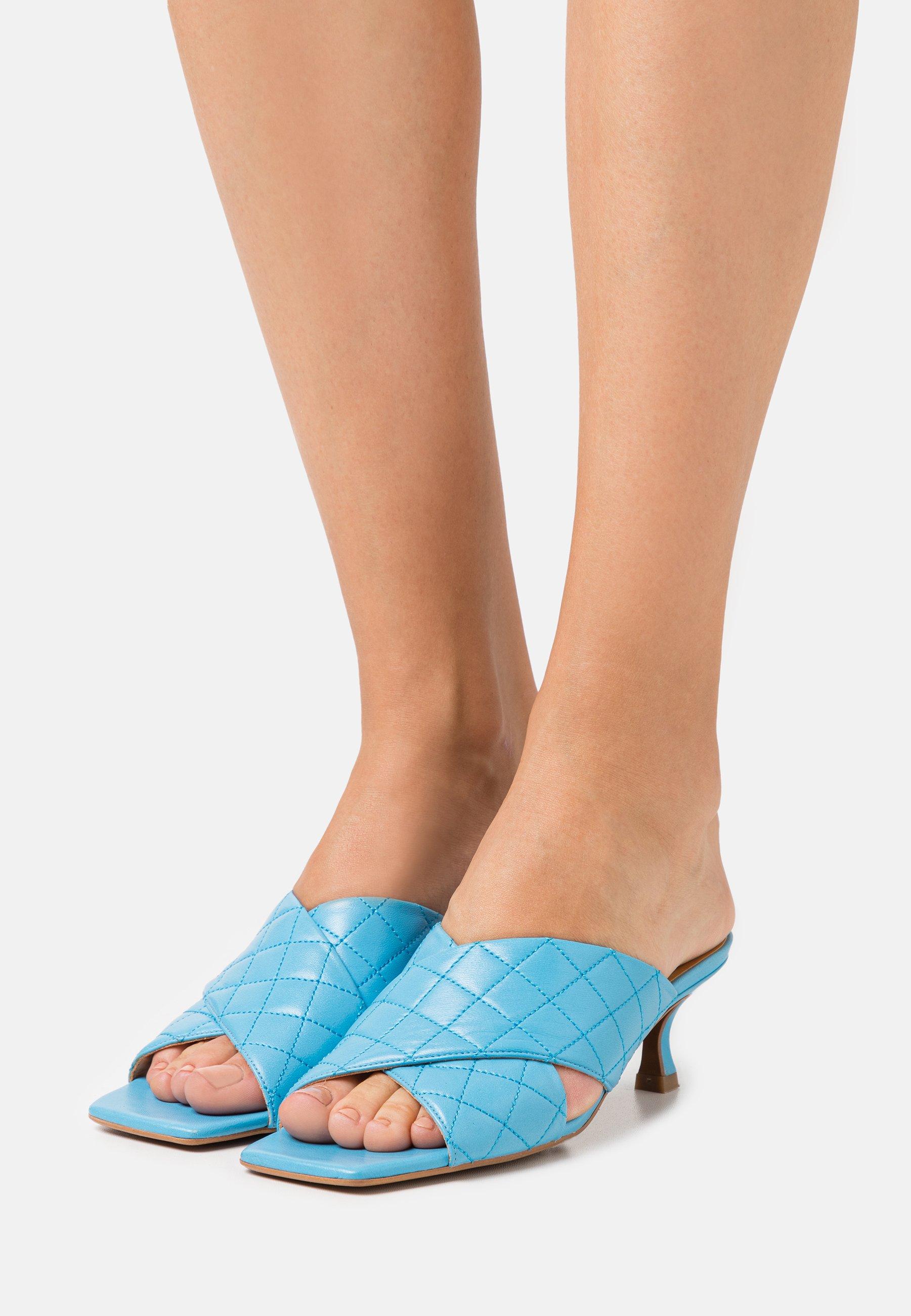 Women Heeled mules - clear blue