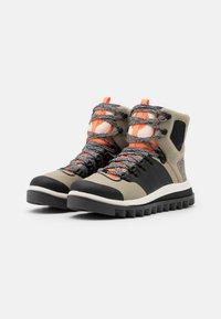 adidas by Stella McCartney - EULAMPIS - Vinterstøvler - tech beige/core black/solar orange - 1