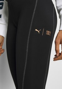 Puma - THE FIRST MILE ECLIPSE TIGHT - Tights - black/burnt russet
