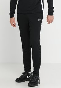 Nike Performance - DRY ACADEMY - Tracksuit bottoms - black/white - 0