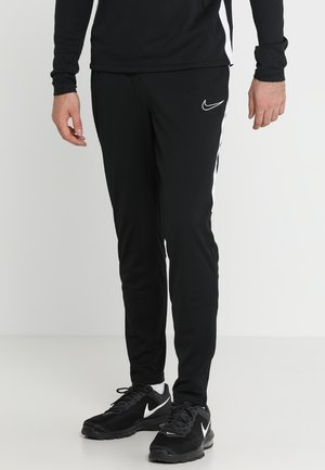 DRY ACADEMY - Tracksuit bottoms - black/white