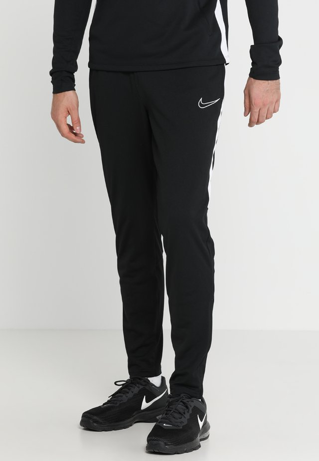 DRY ACADEMY - Pantalon de survêtement - black/white