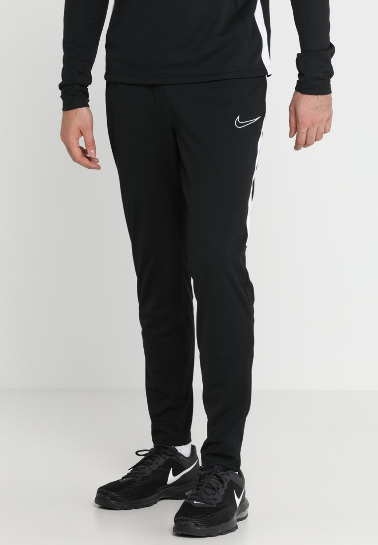 Nike Performance - DRY ACADEMY - Tracksuit bottoms - black/white
