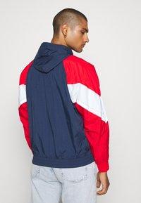 Nike Sportswear - Windbreaker - midnight navy/university red/white - 2