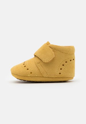 PETIT UNISEX - Slippers - mustard