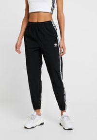 adidas Originals - LOCK UP ADICOLOR NYLON TRACK PANTS - Jogginghose - black - 0