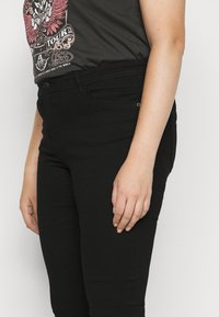 Vero Moda Curve - VMTANYA PIPING - Jeans Skinny Fit - black - 5