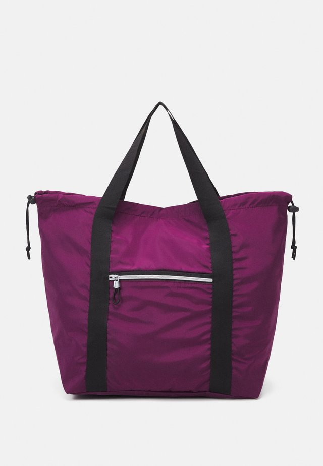 CHERYL SAC - Sports bag - prune