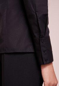 HUGO - ETRIXE - Button-down blouse - black - 4