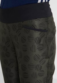 adidas Golf - PRINTED PULLON ANKLE PANT - Bukser - black - 4