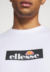 Ellesse - OMBRONO - Triko spotiskem - white - 5