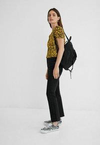 Desigual - ANIMAL PRINT - Print T-shirt - yellow - 1