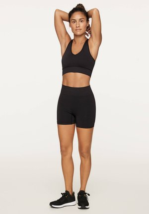 SEAMLESS HOT - Korte sportsbukser - black