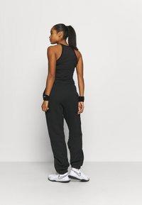 Nike Performance - HERITAGE PANT - Tracksuit bottoms - black - 2