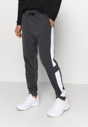 LAITO TRACK - Tracksuit bottoms - black/bright white
