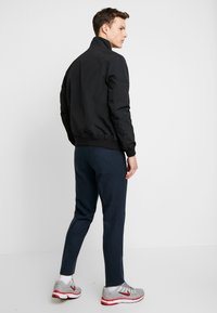 Tommy Jeans - ESSENTIAL JACKET - Giacca leggera - black - 2