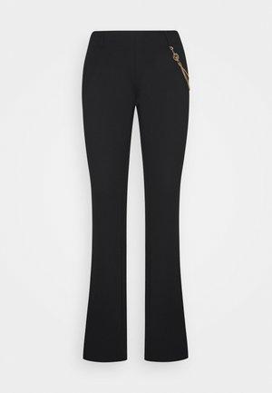 PANTALONE BOOTCUT - Trousers - black