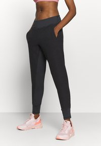 Puma - STUDIO FITTED PANT - Tracksuit bottoms - black - 0
