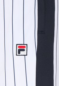 Fila - HALA TRACK PANTS - Trousers - blanc de blanc/black iris - 5