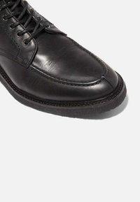 AllSaints - INDIANNA  - Lace-up ankle boots - black - 4