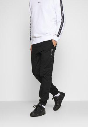 ELASTIC CUFF PANTS - Verryttelyhousut - black