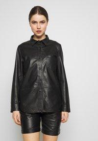 STUDIO ID - RIKE - Button-down blouse - black - 0