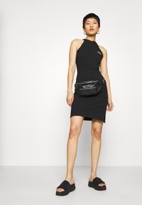 Puma - BODYCON DRESS - Shift dress - black - 1