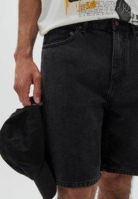 PULL&BEAR - BERMUDA - Denim shorts - mottled black - 3