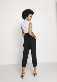 Steffen Schraut - CAROL DARLING PANTS - Trousers - black - 2