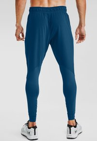 Under Armour - HYBRID - Tracksuit bottoms - graphite blue - 1
