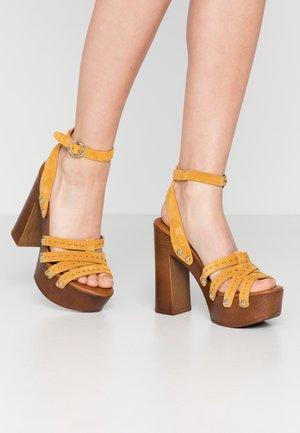 HENDRA - Clogs - yellow