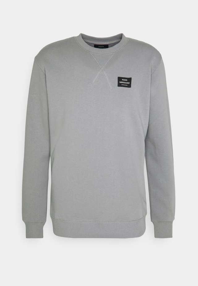 NEW STANDARD CREW LABEL - Sweatshirt - momument