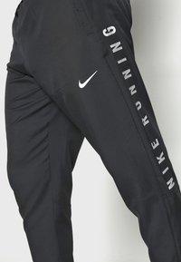 Nike Performance - NIKE RUN DIVISION - Pantalon de survêtement - black/silver - 3