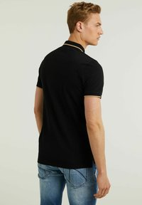 CHASIN' - Polo shirt - black - 1