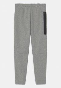 Nike Sportswear - Tracksuit bottoms - dark grey heather - 1