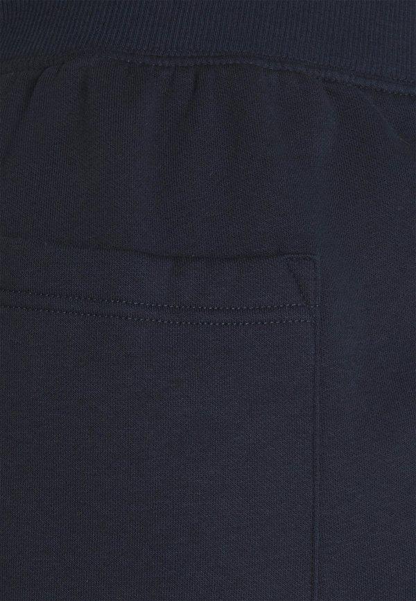 Pier One Spodnie treningowe - dark blue/granatowy Odzież Męska RJXE