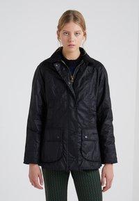 Barbour - BEADNELL WAX JACKET - Waterproof jacket - black - 0