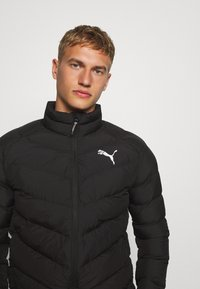 Puma - WARMCELL LIGHTWEIGHT JACKET - Winterjas - black - 0