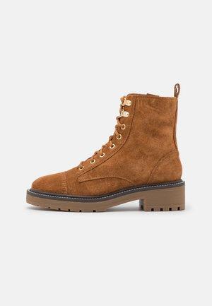 Platform ankle boots - brown light