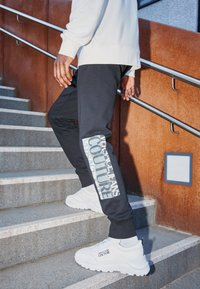 Versace Jeans Couture - Tracksuit bottoms - nero - 3